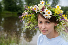 Girl in camomile chaplet. Portrait of beauty girl in flower chaplet royalty free stock images