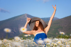 Girl on camomile field Royalty Free Stock Images