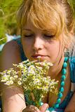 Girl with camomile flowers Stock Images