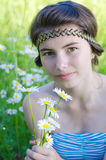 GIRL ON CAMOMILE MEADOW. Beautiful young girl on the camomile meadow Stock Photo