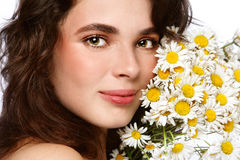 Girl with camomiles Stock Image