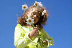 The girl with camomiles Stock Images