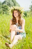 Girl  in camomiles chaplet Royalty Free Stock Photography