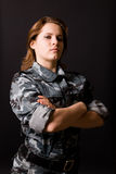 Girl in camouflage clothing. Young girl in camouflage clothing Royalty Free Stock Image