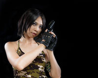 Girl in camouflage clothing holding a gun Royalty Free Stock Images