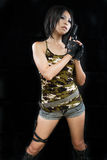 Girl in camouflage clothing holding a gun Stock Images
