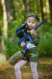 Girl in camouflage suit with rifle Stock Images