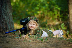 Girl in camouflage suit with rifle Stock Photo