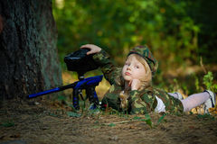 Girl in camouflage suit with rifle Royalty Free Stock Photography
