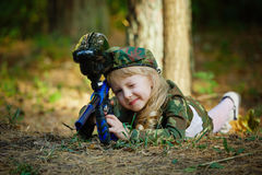 Girl in camouflage suit with rifle Royalty Free Stock Photos
