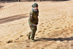 Girl in camouflage walking Royalty Free Stock Photo