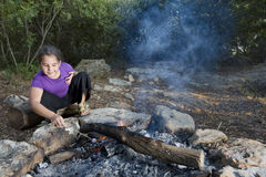 Girl  and campfire Royalty Free Stock Photo