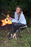 Girl at campfire Royalty Free Stock Photo