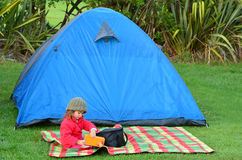 Girl on camping holiday Stock Images