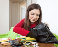 Girl can not finding anything in  purse Royalty Free Stock Photos