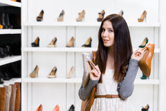 Girl can't choose stylish pumps Royalty Free Stock Photo