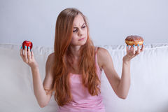 Girl can't eat donut Stock Images