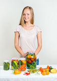 A girl can the vegetables Stock Photo