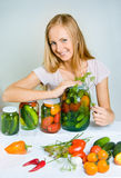 A girl can the vegetables Royalty Free Stock Photos