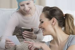 Girl with cancer and caregiver Stock Images
