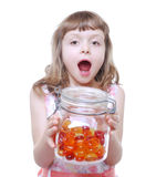Girl with candies Stock Photography