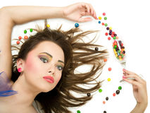Girl with candies Royalty Free Stock Images