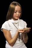 Girl with candle. On black background Royalty Free Stock Photo