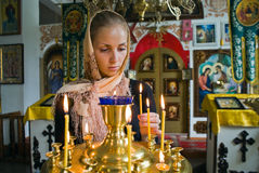 Girl with a candle. Girl with a candle in the Orthodox Church Royalty Free Stock Image