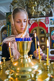 Girl with a candle. Girl with a candle in the Orthodox Church Stock Photos