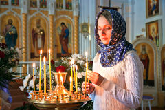 Girl with a candle. Girl with a candle in the Orthodox Church Royalty Free Stock Images