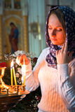Girl with a candle. Girl with a candle in the Orthodox Church Royalty Free Stock Photography