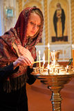 Girl with a candle. Girl with a candle in the Orthodox Church Stock Image