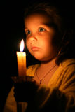 Girl with candle. Portrait of the girl with a candle in hands Royalty Free Stock Photos