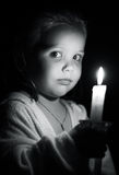Girl with candle Stock Photos