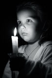 Girl with candle Stock Images