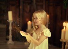 Girl with a candle Stock Photography