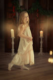 Girl with a candle Royalty Free Stock Photos
