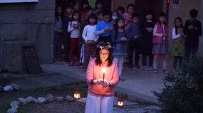 Girl with candle in ceremony