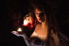 Girl with candle on hand Royalty Free Stock Photos