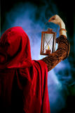 Girl with a candle-lantern. Girl in red cloak with a candle-lantern Royalty Free Stock Photography