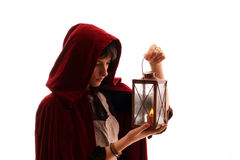 Girl with a candle-lantern. Girl in red cloak with a candle-lantern, isolated on white Stock Images