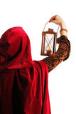 Girl with a candle-lantern. Girl in red cloak with a candle-lantern, isolated on white Royalty Free Stock Image