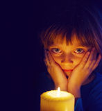 Girl with a candle. A little girl with a candle Royalty Free Stock Image