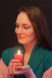Girl with a candle Stock Image