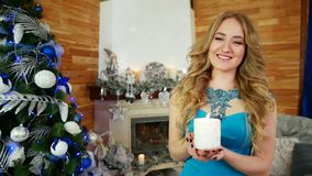 Girl and candle Portrait of a young woman with a white candle in his hand, she holds a Christmas fire near the Christmas stock video footage