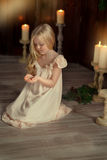 Girl with a candle Royalty Free Stock Images