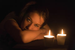 Girl in the candlelight Stock Photo