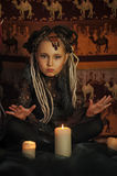 Girl with candles Royalty Free Stock Images