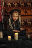 Girl with candles Royalty Free Stock Image
