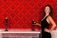 Girl with candles glamour fashion girl in red vintage room with. A candle in hand luxury and glossy photography Stock Images